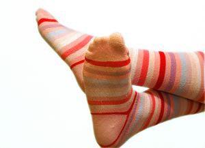 home remedies for cracked heels : wearing socks